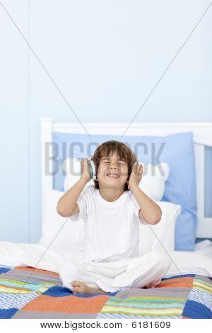 Little Boy Listening To Music On Headphones