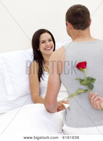 Husband Surprising His Beautiful Wife With A Rose