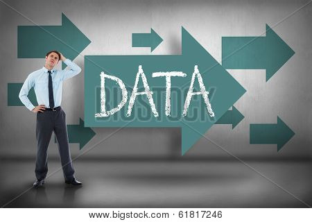 The word data and thoughtful businessman with hand on head against blue arrows pointing
