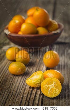 Tasty Kumquats On A Wooden Top