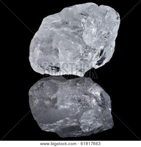 single white transparent Quartz, Rock Crystal with reflection on black surface background