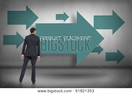 The word product placement and asian businessman against blue arrows pointing