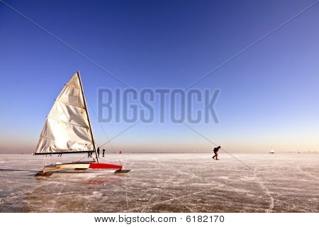 Traditional dutch: Ice sailing on a cold winterday in the Netherlands