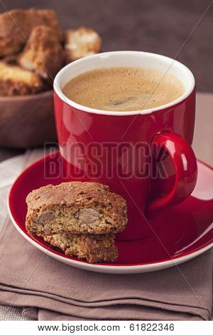 Cantuccini and a cup of coffee on a brown background
