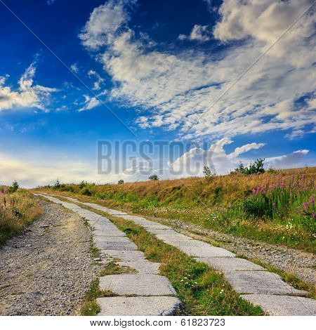 Road Of Concrete Slabs Uphill To The Sky