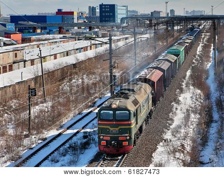 Goods Train Carries Cargo On Railway Track.