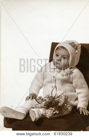 ZGIERZ, POLAND, FEBRUARY 5, 1972: Vintage photo of a baby at his christening