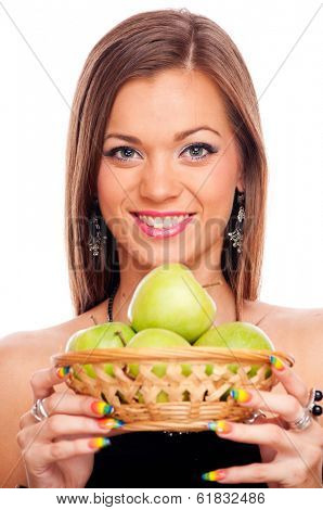 Beautiful brunette holding punnet with green apples, isolated on white
