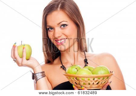 Beautiful brunette holding green apple in one hand and punnet with green apples in the second hand, isolated on white