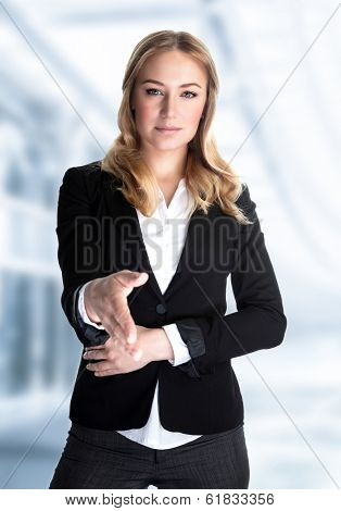 Portrait of cute blond girl stretches out her hand for a handshake, work in great financial company, young business professional make a deal