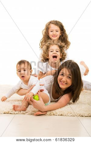 Mother And Kids Having Fun Home