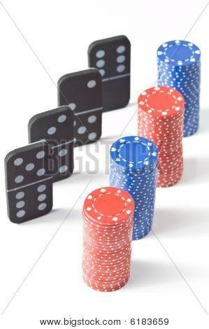 Stacks Of Poker Chips And Dominoes