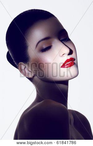 close-up portrait of caucasian brunette wearing red lipstick, spot lighting
