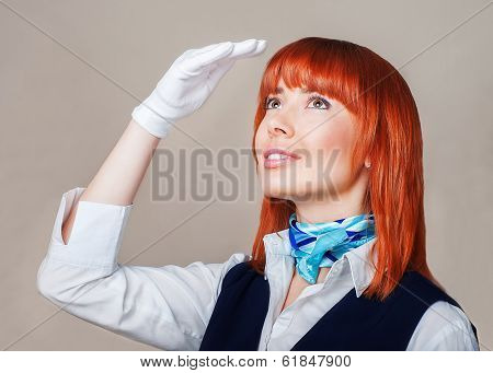 Stewardess In Blue And White Uniform With Red Hair