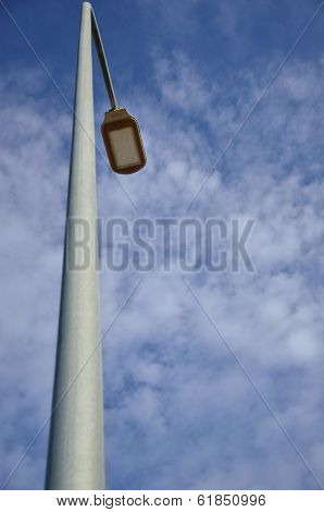 One street lamp against a deep blue sky