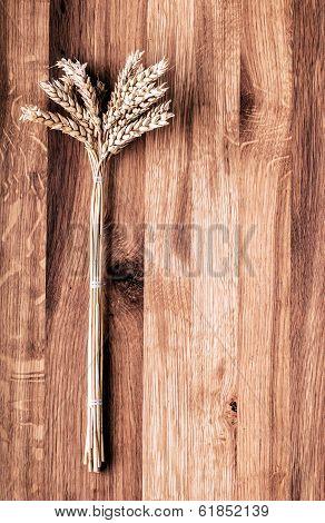 Bundle Of Wheat On Wood.