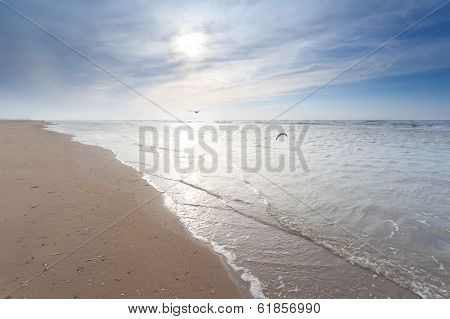 Sunshine Over Sand Beach In North Sea