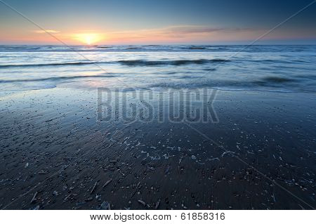 Sunset Over Sand Beach At Low Tide On North Sea