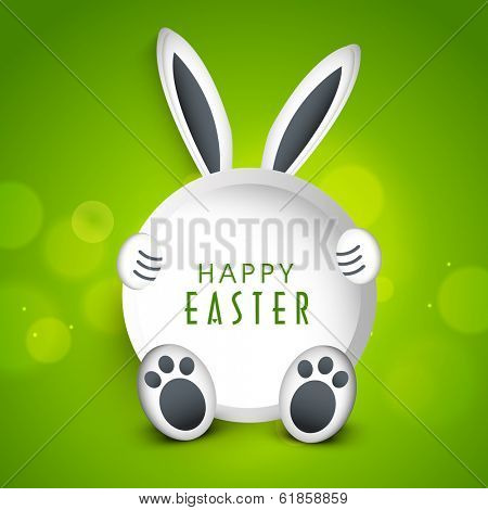 Happy Easter celebration sticky in a bunny shape on shiny green background.