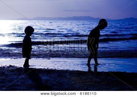 Kids Playing On Te Beach