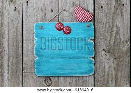 Blank blue antique sign with cherry soda bottle tops