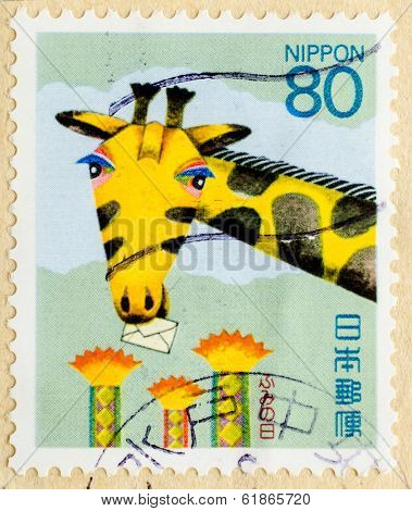 JAPAN - CIRCA 1994: stamp printed in Japan, shows Giraffe with Letter, circa 1994