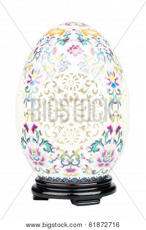 Porcelain easter egg with stand isolated on white