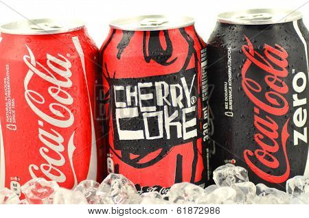 Can of Coca-Cola, Cherry Coke and Coca-Cola Zero drinks on ice
