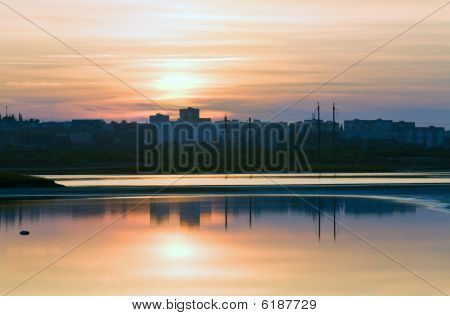 Sunset Sky And It Reflection In Lake