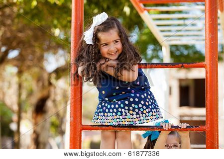 Pretty little girl playing in a park