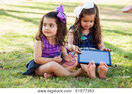 Cute girls with a table computer