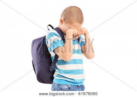 Sad schoolboy crying isolated on white background