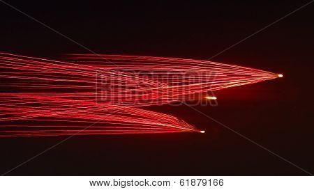 Red fireworks light trails