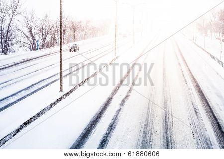 Disturbing Sunset Light And Snowstorm On Highway