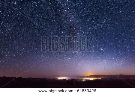 Lunar dawn over the ridge Chandalaz in Russia