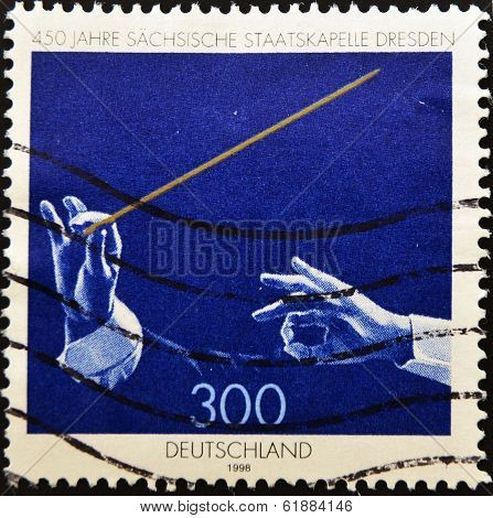 GERMANY - CIRCA 1985: A stamp printed in germany shows a orchestra conductor circa 1985