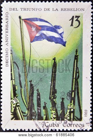 A stamp printed in Cuba celebrating the tenth anniversary of the triumph of the revolution