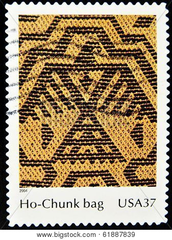 A stamp printed in United States of America shows the detail of a mythological creature in a bag