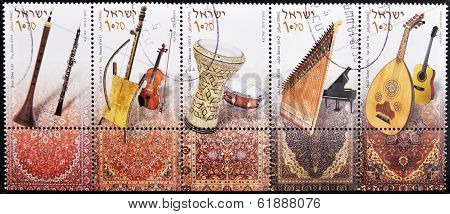 ISRAEL - CIRCA 2010: A set of five stamps printed in Israel shows different musical instruments