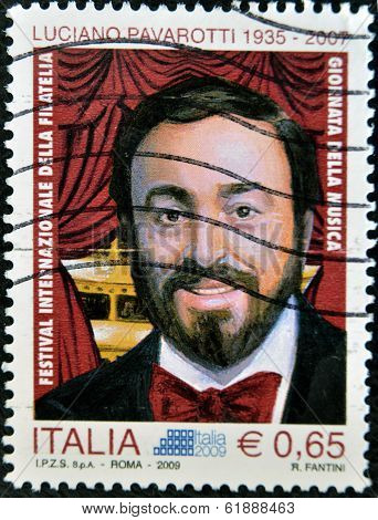 ITALY - CIRCA 2009: A stamp printed in Italy shows Luciano Pavarotti famous tenor circa 2009