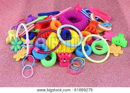 Colorful barrette and Scrunchy on pink background