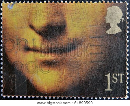 stamp printed by United Kingdom shows Mona Lisa or La Gioconda by Leonardo da Vinci Louvre Paris