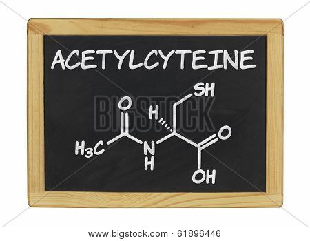 chemical formula of acetylcysteine on a blackboard