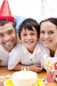 foto of happy birthday  - Portrait of smiling family celebrating son - JPG