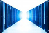 stock photo of mainframe  - row of server racks with strong light from the end - JPG