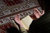 foto of muslim man  - Young Muslim Man Is Reading The Koran - JPG
