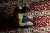 stock photo of muslim man  - Muslim Man Is Praying In The Mosque - JPG