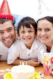pic of happy birthday  - Portrait of smiling family celebrating son - JPG