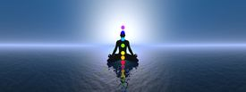 stock photo of ohm  - Silhouette of a man meditating with seven colorful chakras upon ocean by blue sunset - JPG