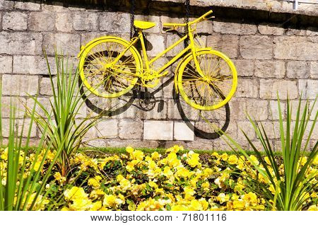 Yellow bicycle exposed in York city as a symbol of Tour de France through Yorkshire, UK